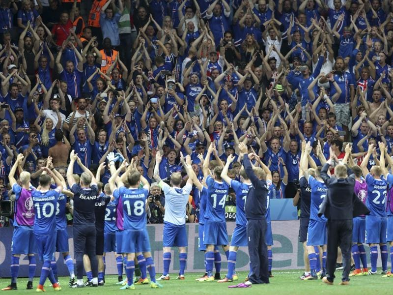 Iceland players celebrate with their supporters at the end of the Euro 2016 round of 16 football match between England and Iceland. Iceland, the smallest nation at the Euros, have reached the quarterfinals on their first appearance at a major international tournament. After their 1-1 draw against Portugal in the opener, Cristiano Ronaldo had controversially described the team as having a 'small mentality'.  (AP PHOTO)