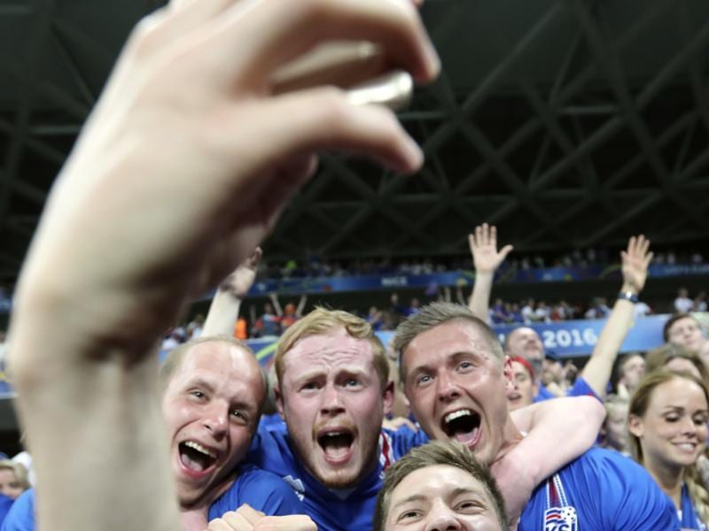 Iceland's Haukur Heidar Hauksson takes a selfie with supporters after a  historic win. (AP PHOTO)