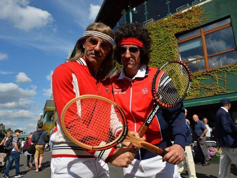 Spectators dressed to resemble former champions Bjorn Borg (L) and John McEnroe (R) pose for a photograph.  (AFP)
