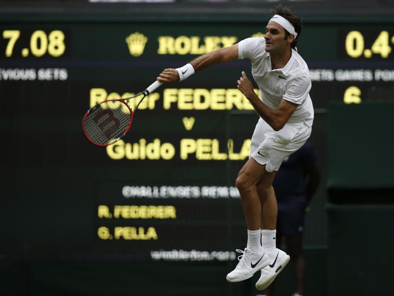 Switzerland's Roger Federer serves during his 7-6 (5), 7-6 (3), 6-3 win over Argentina's Guido Pella in the first round. (AFP)