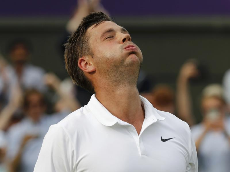 Ranked 772, Willis won his first ever tour-level match to assure himself of £50,000 and a second-round meeting with seven-time champion Roger Federer. (REUTERS)