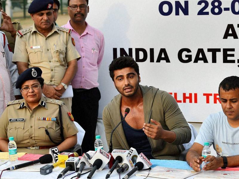 Arjun Kapoor and author Chetan Bhagat address the media after an awareness campaign for road safety organised by Delhi Traffic Police at India Gate in New Delhi. (PTI)