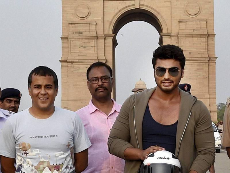 Bollywood actor Arjun Kapoor and author Chetan Bhagat participated in an awareness campaign for road safety organised by Delhi Traffic Police at India Gate in New Delhi on Tuesday.  (PTI)