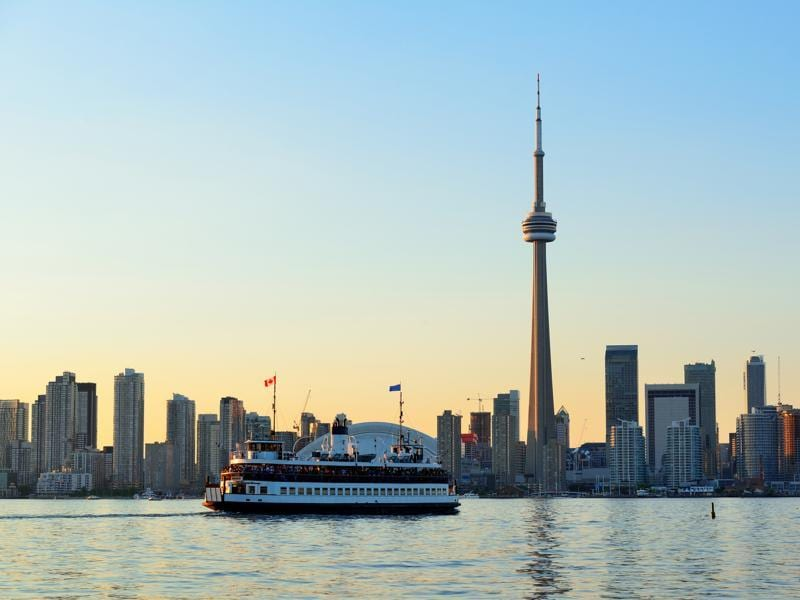 Toronto was ranked the second best place to visit in Canada for 2016. Toronto skyline in the day over lake with urban architecture and blue sky.  (iStockphoto)