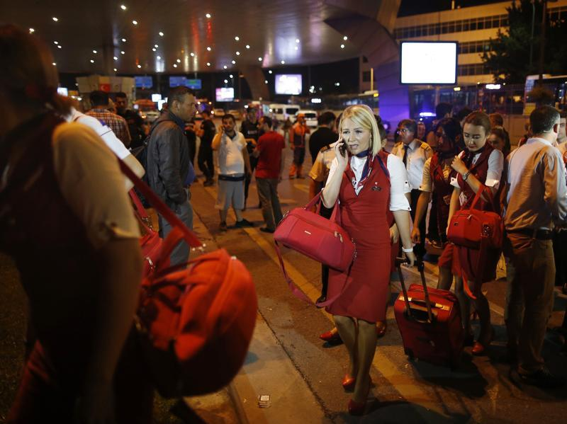 Members of a flight crew leave Ataturk airport early on Wednesday after blasts at the airport. (AP)