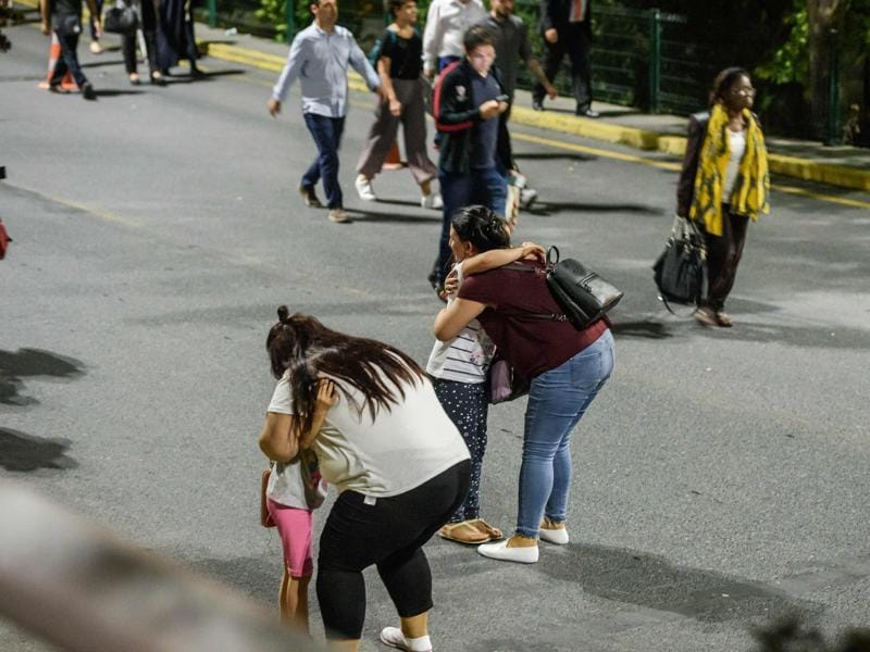 Mothers calm their children frightened after the deadly attacks at the Ataturk airport on Tuesday. (AFP)