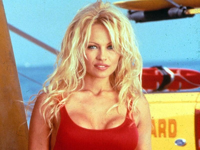 Her big break came when she joined TV show Baywatch in 1992. She made slow motion running the red monokini super iconic. (Twitter)