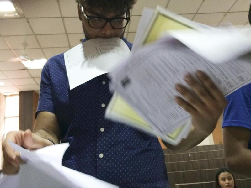 After the first cutoff list is released, hundreds of students are in a fix trying to make sense of the admission list. Here's one getting baffled with all the forms at the Sri Venkateshwar College in New Delhi on Thursday. (Saumya Khandelwal/ HT Photo)