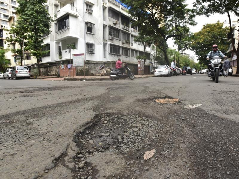 Matunga, near Starcity cinema: The pothole menace is spread far and wide. From western suburbs to Navi Mumbai, the cracks are showing up everywhere.  (Kunal Patil/ Hindustan Times)
