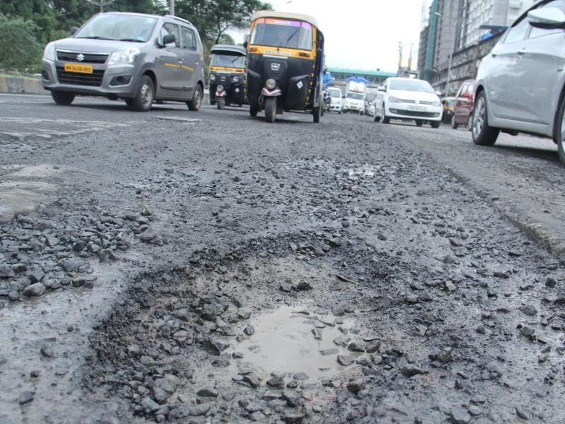 WEH, KANDIVLI: The Western Express Highway, which is the link between Dahisar and Bandra, has witnessed more than 70 potholes in the past few days. (Pramod Thakur/ Hindustan Times)