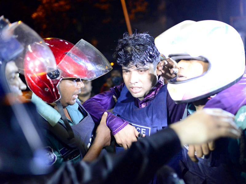 An injured member of the police personnel is carried away by his colleagues near the attack site in Dhaka. (Reuters Photo)