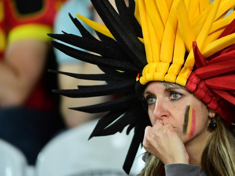 A Belgium supporter reacts after the Euro 2016 quarterfinal football match between Wales and Belgium at the Pierre-Mauroy stadium in Villeneuve-d'Ascq near Lille. Wales won the match 3-1. (AFP Photo)