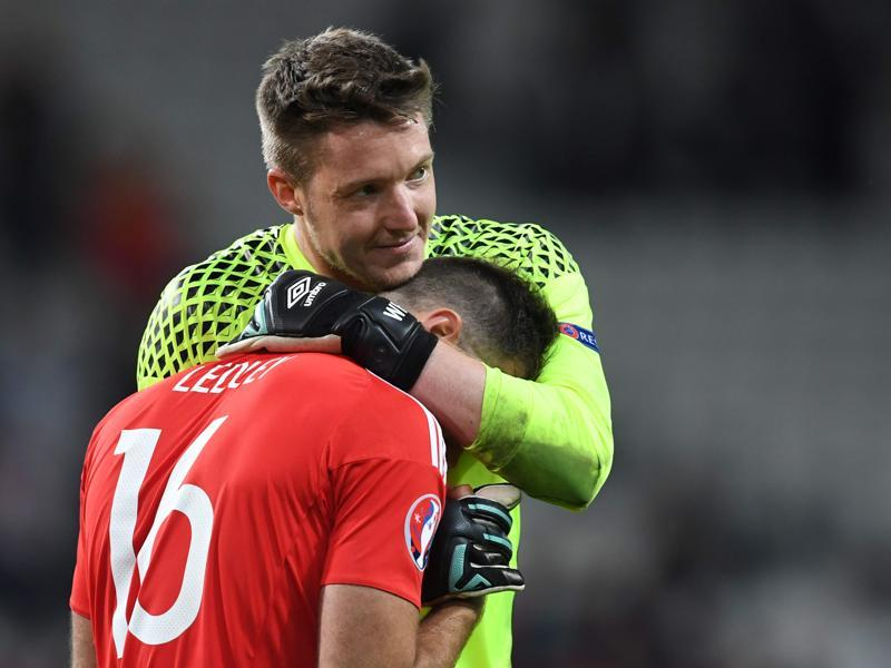 Wales' midfielder Joe Ledley (front) and Wales' goalkeeper Wayne Hennessey celebrate after winning the Euro 2016 quarterfinal match against Belgium.  (AFP Photo)