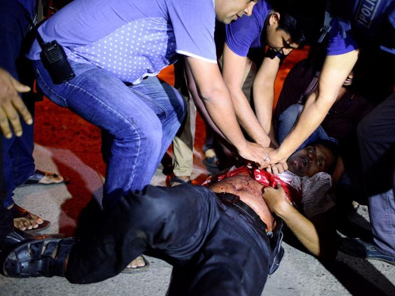 People try to help an injured person, near the attack site. (Reuters Photo)