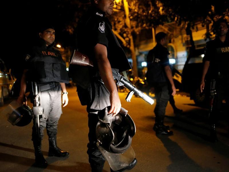 Security personnel keep watch, in the Gulshan area of Dhaka. (Reuters Photo)
