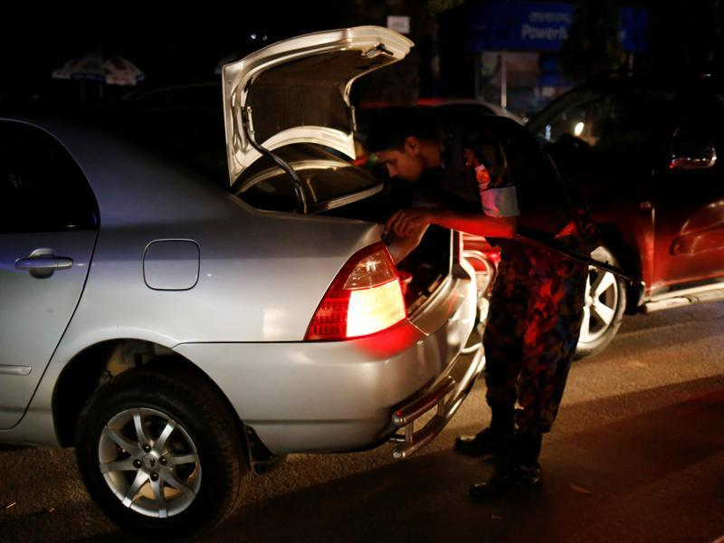 Security personnel check vehicles in the Gulshan area of Dhaka. (Reuters Photo)