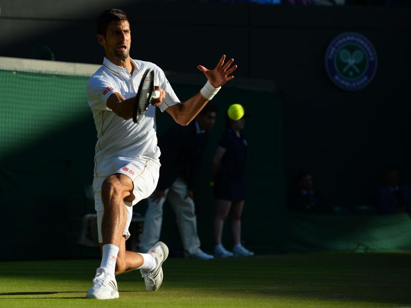 Serbia's Novak Djokovic returns to US player Sam Querrey during their men's singles third round match on the fifth day of the 2016 Wimbledon Championships at The All England Lawn Tennis Club in Wimbledon, southwest London. (AFP Photo)
