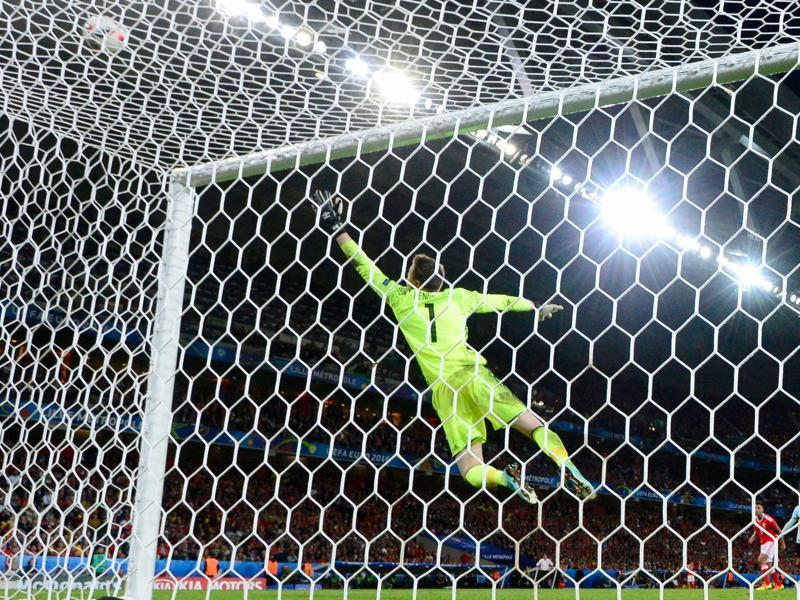 Wales' goalkeeper Wayne Hennessey jumps for the ball during the Euro 2016 quarterfinal match between Wales and Belgium at the Pierre-Mauroy stadium. (AFP Photo)