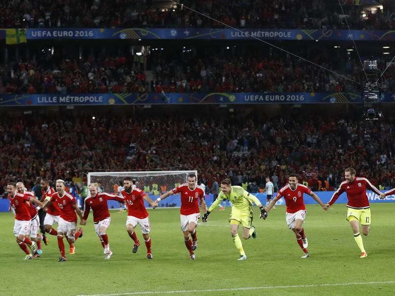 Wales players celebrate after defeating Belgium 3-1 in their Euro 2016 quarterfinal clash.  (Reuters Photo)
