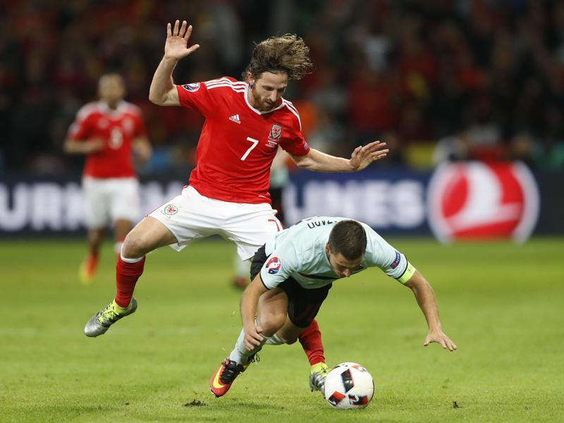 Wales' Joe Allen fouls Belgium's Eden Hazard. (Reuters Photo)