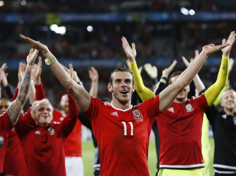 Wales' forward Gareth Bale and teammates celebrate at full time after thumping World No. 2 Belgium 3-1 in the Euro 2016 quarterfinals.  (Reuters Photo)