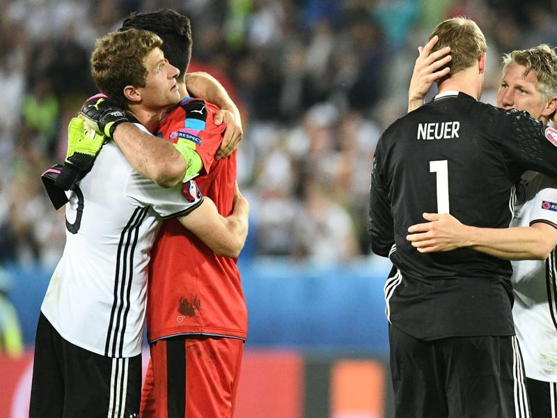 Italy's goalkeeper Gianluigi Buffon (2nd left) congratulates Germany's midfielder Thomas Mueller as Germany's goalkeeper Manuel Neuer celebrates with Bastian Schweinsteiger (right) after Germany won the match. (AFP Photo)
