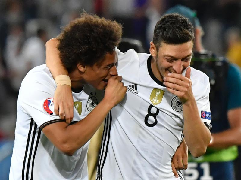 Germany's midfielder Mesut Ozil (right) and Germany's midfielder Leroy Sane celebrate after winning the Euro 2016 quarterfinal football match. (AFP Photo)
