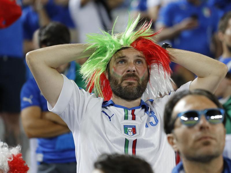 Italy fans react after the team lose the penalty shootout. (Reuters Photo)