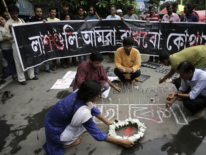 Indian activists participate in a candle light vigil protesting the Bangladesh restaurant attack, in Kolkata on Saturday. (AP)