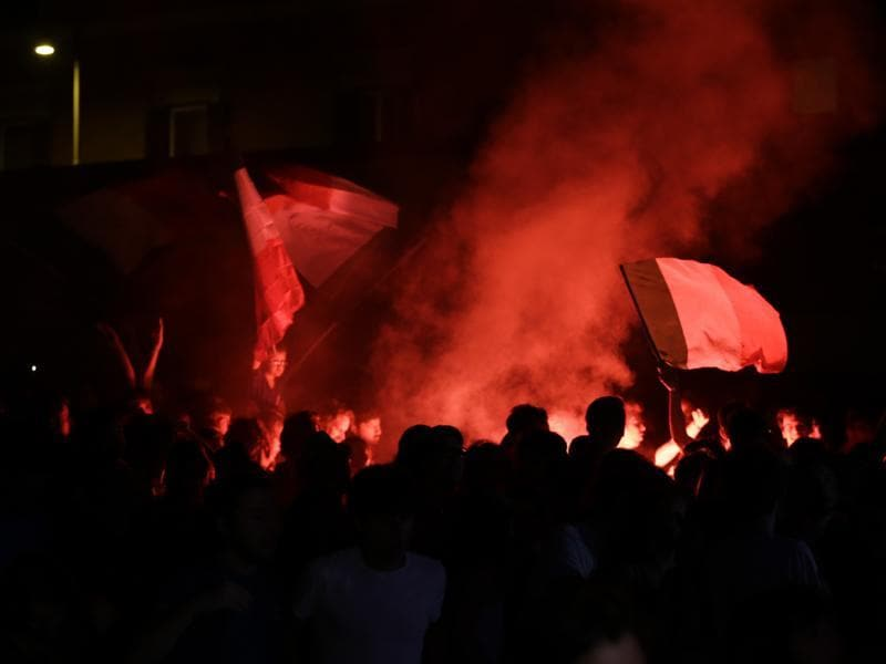 Supporters in Rome light flares after Italy scored, as they watched the live broadcast of the Euro 2016 quarterfinal match between Italy and Germany. (AP Photo)
