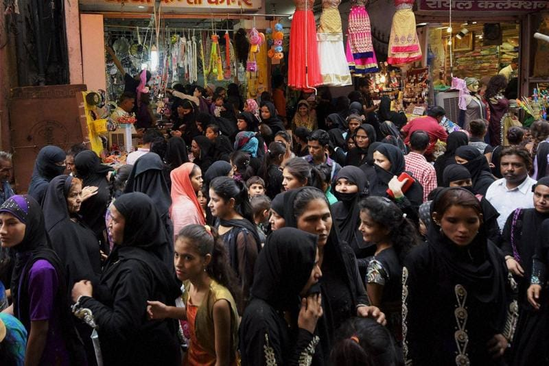 Muslim women busy in shopping for the festival of Id-ul-Fitr at Pink City in Jaipur on Sunday.  (PTI)