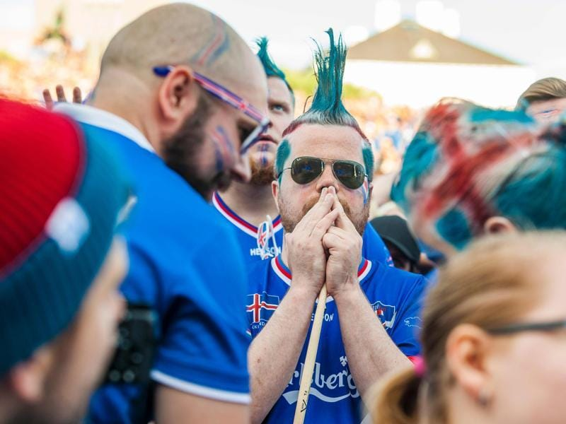 Iceland's  blue mohawk  fans react as  Iceland finish with an 'icy' stop at the Euro 2016. (AFP PHOTO)