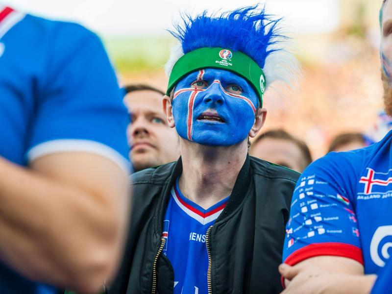 Iceland's fans react  with disappointment  over their crippling loss. (AFP photo)