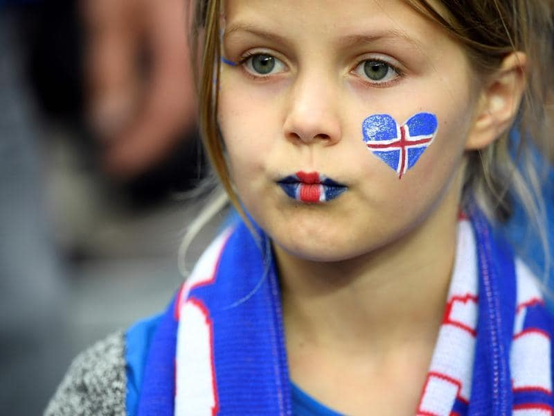 A young Iceland supporter looks on at the start of the Euro 2016 quarter-final football match between France and Iceland. (AFP photo)
