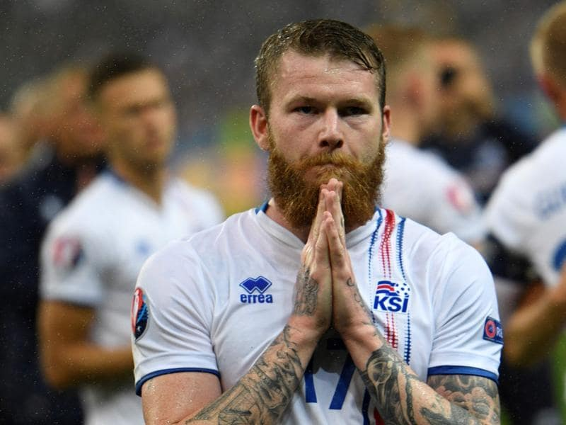 Iceland's midfielder Aron Gunnarsson reacts after the Euro 2016 quarter-final  loss with the universal sign of  seeking forgiveness  and  showing gratitude. (AFP photo)