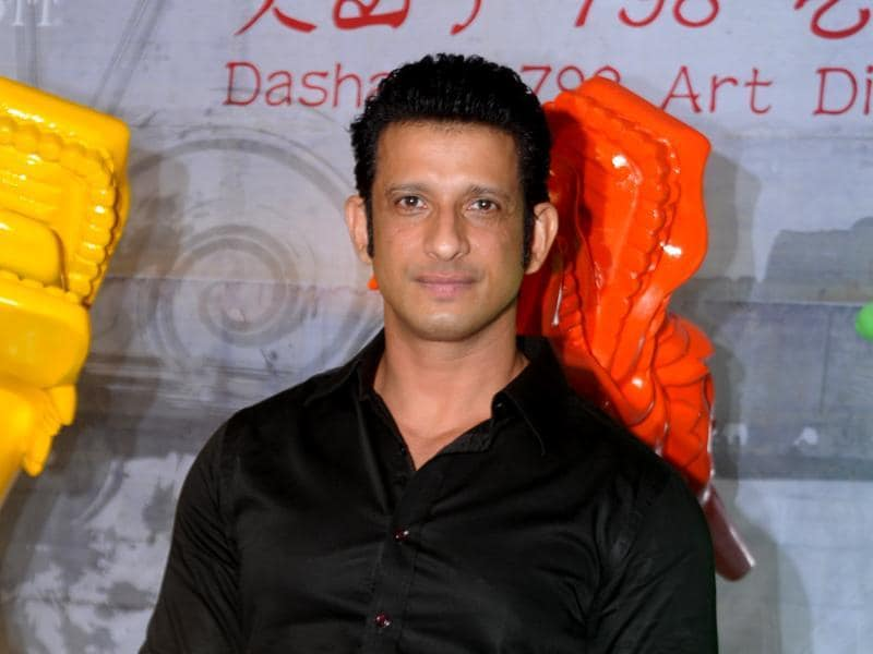 Sharman Joshi poses for the shutterbugs a party for a newly-opened restaurant in Mumbai. (AFP)