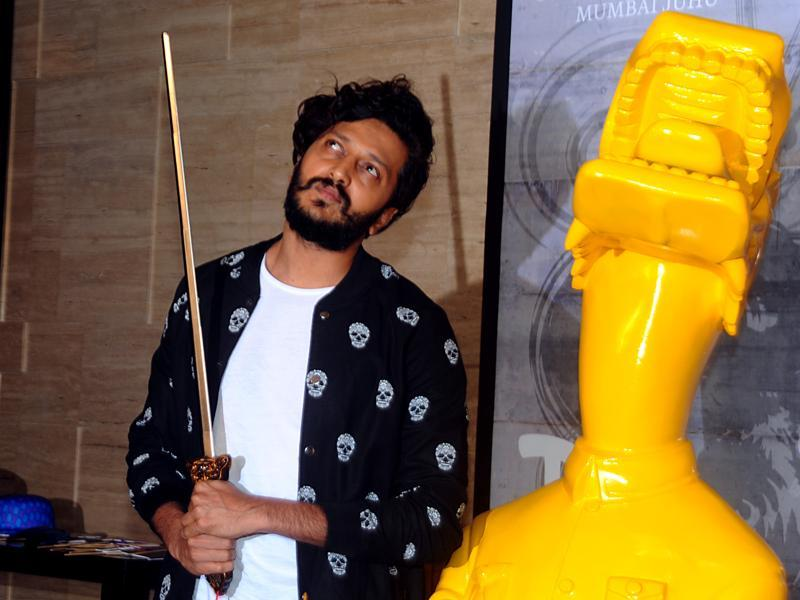 Riteish Deshmukh apes the statue at party for a newly-opened restaurant in Mumbai. (AFP)