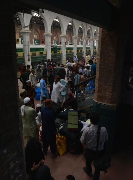 Pakistani passengers gather at a railway station as they prepare to return to their home towns ahead of the Eid al-Fitr festival in Lahore on July 3, 2016. (AFP)