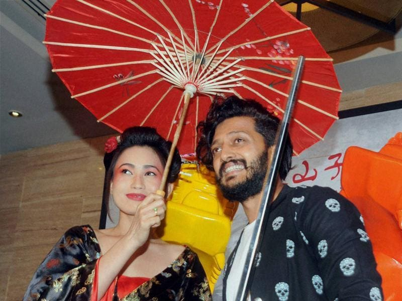 Riteish Deshmukh strikes a pose at a newly-opened restaurant in Mumbai.  (PTI)