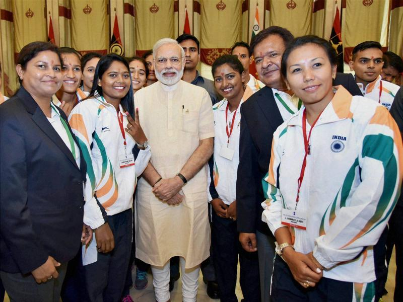 Prime Minister Narendra Modi poses with sportspersons at a send-off ceremony. (PTI Photo)