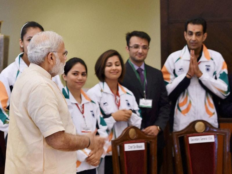Prime Minister Narendra Modi interacts with the athletes and sportspersons. (PTI photo)