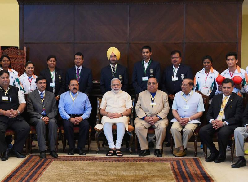 Prime Minister Narendra Modi and Minister of State for Youth Affairs and Sports, Jitendra Singh in a group photograph. (PTI photo)