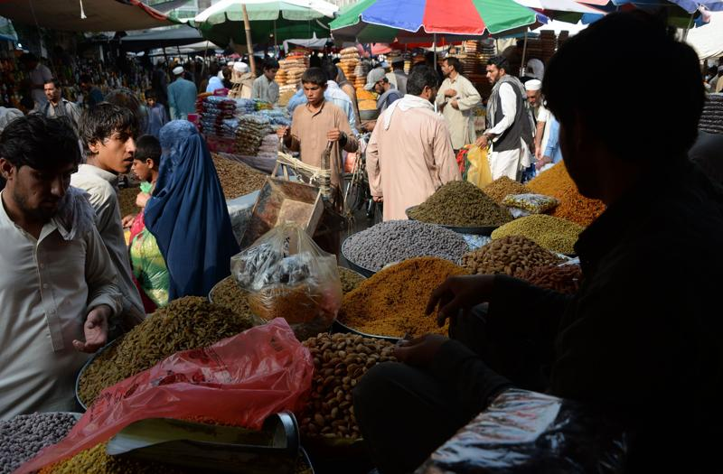 Afghan residents buy dry fruits and sweet for the upcoming Eid Al-Fitr festivities at a local market in Jalalabad on July 3, 2016.  (AFP)