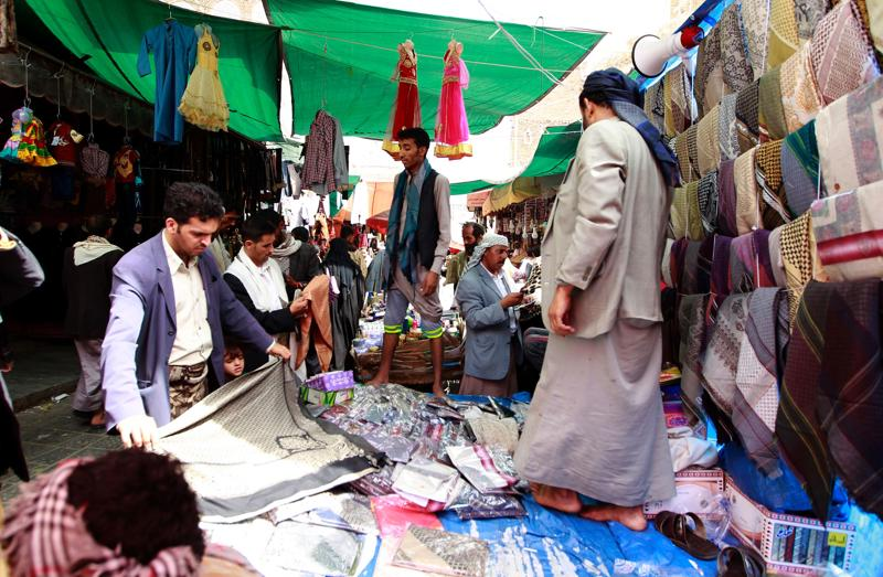 Yemenis shop for clothes at a market in the capital Sanaa on July 3, 2016, ahead of the Muslim holiday of Eid al-Fitr marking the end of the holy fasting month of Ramadan. (AFP)