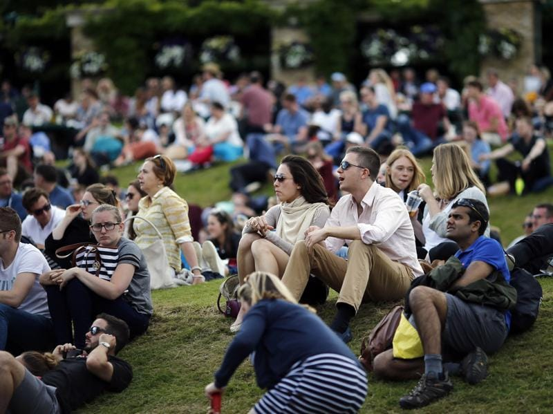 Spectators watch the action during day seven of the Wimbledon Tennis Championships in London. (AP Photo)