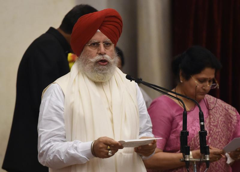 BJP politician, Surendrajit Singh Ahluwalia takes oath as minister of state. (AFP)