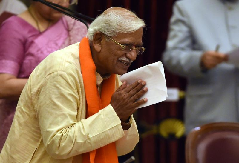 Bharatiya Janata Party (BJP) politician, Ramesh Chandappa Jigjinagi takes the oath as minister of state. (AFP)