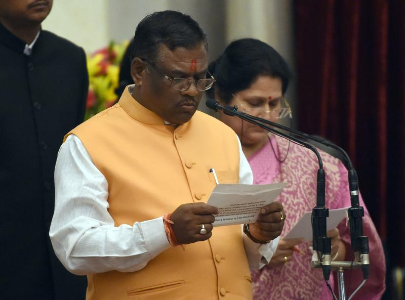 Bharatiya Janata Party (BJP) politician, Faggan Singh Kulaste takes the oath as minister of state. (AFP)