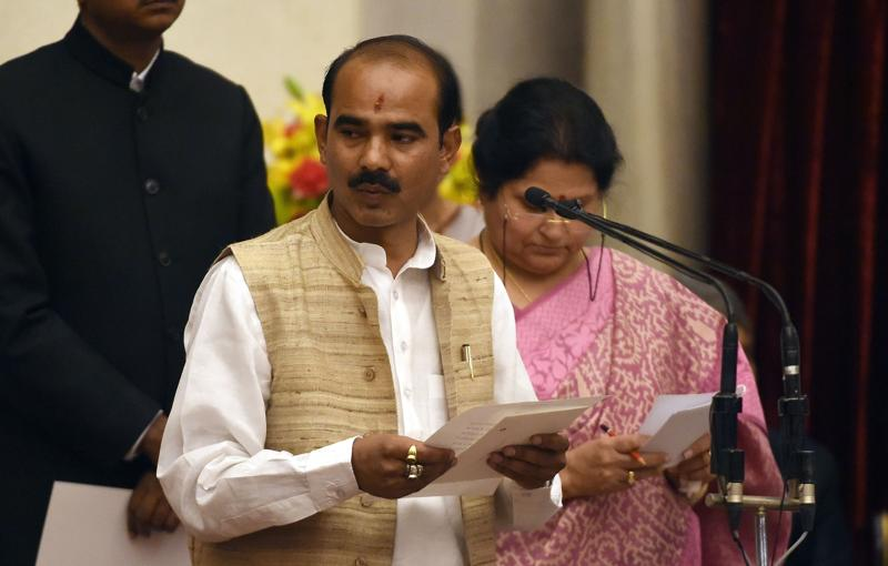 Bharatiya Janata Party (BJP) politician, Ajay Tamta takes the oath as minister of state. (AFP)
