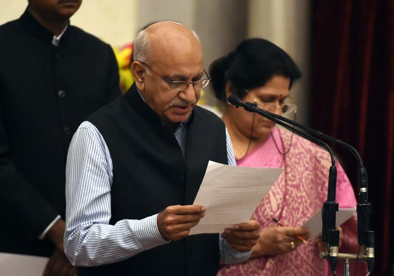 Bharatiya Janata Party (BJP) politician, M. J. Akbar takes the oath as minister of state. (AFP)